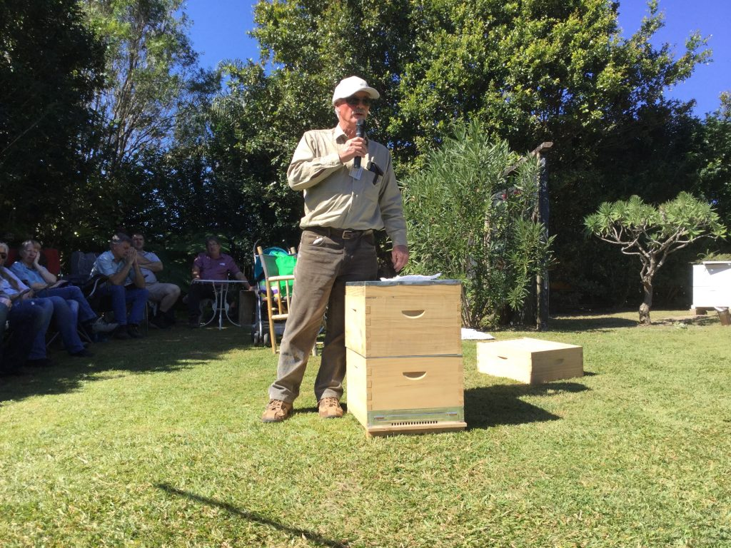 A speaker at a beekeeping club meeting